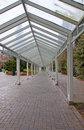 Empty covered walkway this is an with brickwork on the ground on a cloudy overcast day in a city Stock Photo