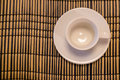 Empty cup on bamboo napkin Royalty Free Stock Photo