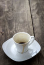 Empty cup of espresso close up on wooden table Royalty Free Stock Image