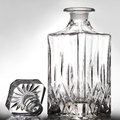 Empty decanter on gray ground Stock Photo