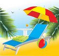 Empty deckchair under an umbrella Royalty Free Stock Images