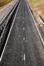 Empty a deserted new dual carriageway road not yet in use as it is uncompleted Stock Photo