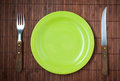 Empty dinner plate knife and fork set Stock Images
