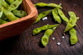 Empty eaten shells of edamame and salt Royalty Free Stock Photos