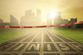 Empty finish line with numbers image of an on the tape and bright sun rays at the end of track Stock Photography
