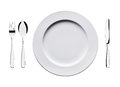 Empty flat plate with spoon, knife and fork isolated on white background. Royalty Free Stock Photo