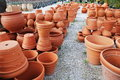 Empty flower pots pele mele display of pottery for sale outside a garden centre Royalty Free Stock Photos