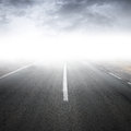 Empty foggy rural asphalt highway perspective with white line Royalty Free Stock Photography