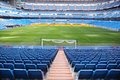 Empty football stadium with seats rolled gates and lawn blue green Stock Images