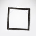 Empty frame crooked classic picture hang on the wall Stock Images