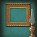 Empty frame on vintage wallpaper and brass oil lam Stock Photos