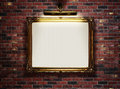 Empty frame on the wall picture with blank canvas hanging a brick in art museum Royalty Free Stock Images