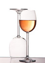 Empty and full crystal wine glasses Royalty Free Stock Photos