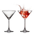Empty and full martini glass with red cocktail Royalty Free Stock Photo