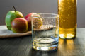 Empty glass, apples, apple wine ready to drink Royalty Free Stock Photo