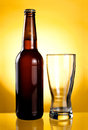 Empty glass and Beer Brown Bottle Royalty Free Stock Image