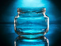 Empty glass jar and open spotlighted Royalty Free Stock Image