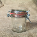 Empty glass jar on textile background Royalty Free Stock Images