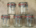 Empty glass jars five on textile background Stock Photo
