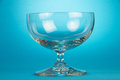 Empty glass pialat the on blue background Stock Photography