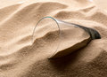 Empty glass in sand Royalty Free Stock Photo