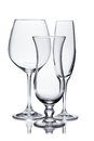 Empty glasses of champagne, red wine and hurricane on white Royalty Free Stock Photo