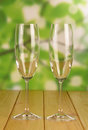 Empty glasses on wooden table over nature background Royalty Free Stock Image