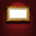 Empty golden frame on the wall. Royalty Free Stock Photo
