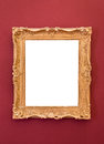 Empty golden picture frame on the wall Royalty Free Stock Photo