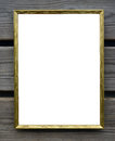 Empty golden picture frame on wooden wall Royalty Free Stock Photo