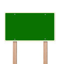 Empty green highway sign in bright sky clipping path Royalty Free Stock Photography