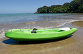 Empty green kayak Stock Photo