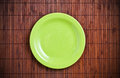 Empty green plate on wooden table Royalty Free Stock Photo