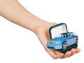 Empty green ring box with blue car in humans hand