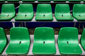 Empty green stadium seats plastic in a or or football field Royalty Free Stock Photos