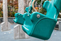 Empty green swings Royalty Free Stock Photo