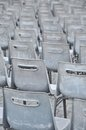 Empty grey chairs in lines Stock Images