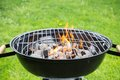 Empty grill burning on garden Stock Photo