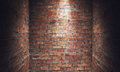 Empty grungy room with red brick wall dead end and spotlight. 3d Royalty Free Stock Photo