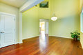 Empty house interior foyer with high ceiling and hardwood floor Royalty Free Stock Photography