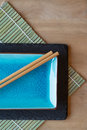 Empty Japanese sushi serving platter with chopsticks Royalty Free Stock Photo