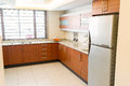 Empty kitchen in newly restored rebuilt house colour image work surfaces Stock Photos