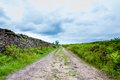 Empty lane with stone fences in lancashire countryside uk Stock Image