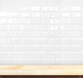 Empty light wood table and white ceramic tile brick wall in back Royalty Free Stock Photo