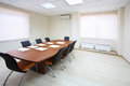 Empty lighting meeting room with long table papers and soft chairs Stock Photo