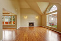 Empty living room with high ceiling and big arch window spacious fireplace new hardwood floor in new house Stock Photography