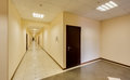 Empty long corridor in the modern office building Royalty Free Stock Photos