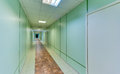 Empty long corridor in the modern office building Royalty Free Stock Photo