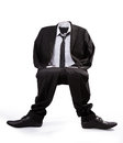 Empty man invisible in formal wear sitting Royalty Free Stock Photo