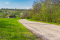 Empty meandering road through small village Petro-Svistunovo in central Ukraine Royalty Free Stock Photo